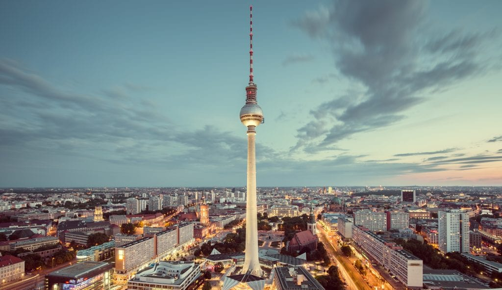 Aerial view of Berlin skyline with famous TV tower at Alexanderplatz and dramatic cloudscape in twilight during blue hour at dusk with retro vintage Instagram style nostalgic pastel toned filter effect, Germany